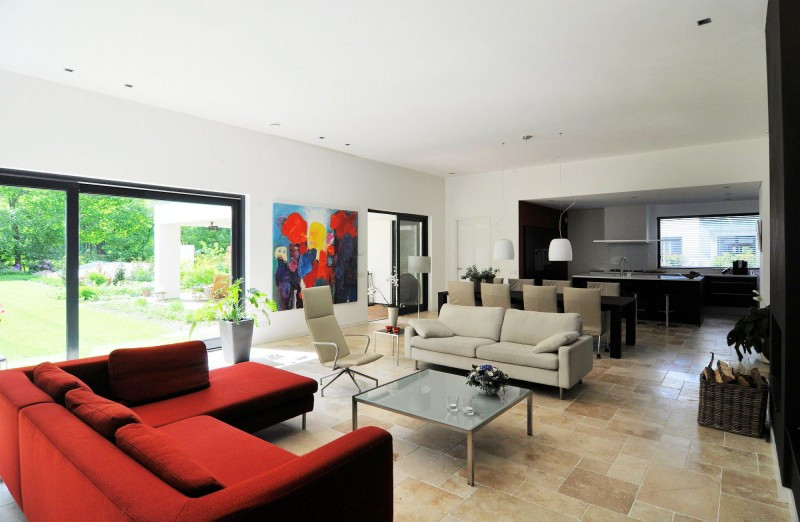 Luxurious-Dutch-Studio-House-Red-Sofa-Marble-Floor-White-Ceiling-Design.jpg