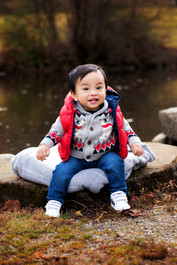 1 year old toddler sitting by the duck pond at Queen Elizabeth Park by Vancouver family photographer Amber Theresa Photography.