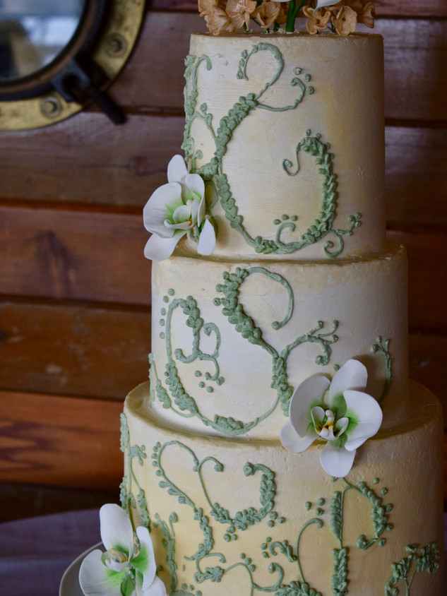 Sugar orchids and hand piping on three-tier antique cake