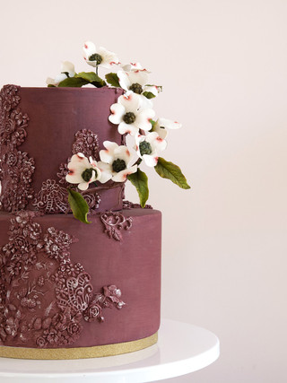 Burgundy cake with bas-relief and sugar flowers
