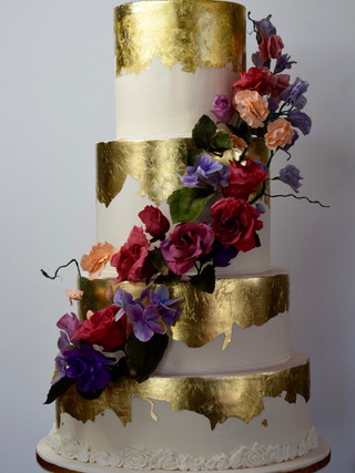 4 tier cake with gold leaf and sugar flower cascade