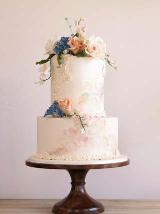 Wedding cake with sugar flower topper and water color