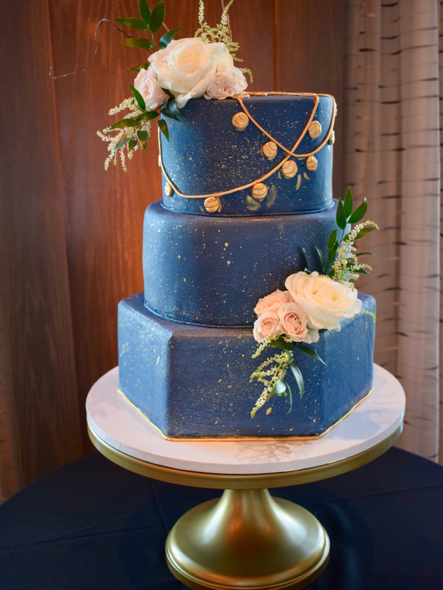 Three tier cake with hexagon tier and fresh flowers