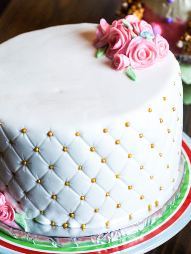 First birthday cake with quilted fondant and rolled fondant flowers