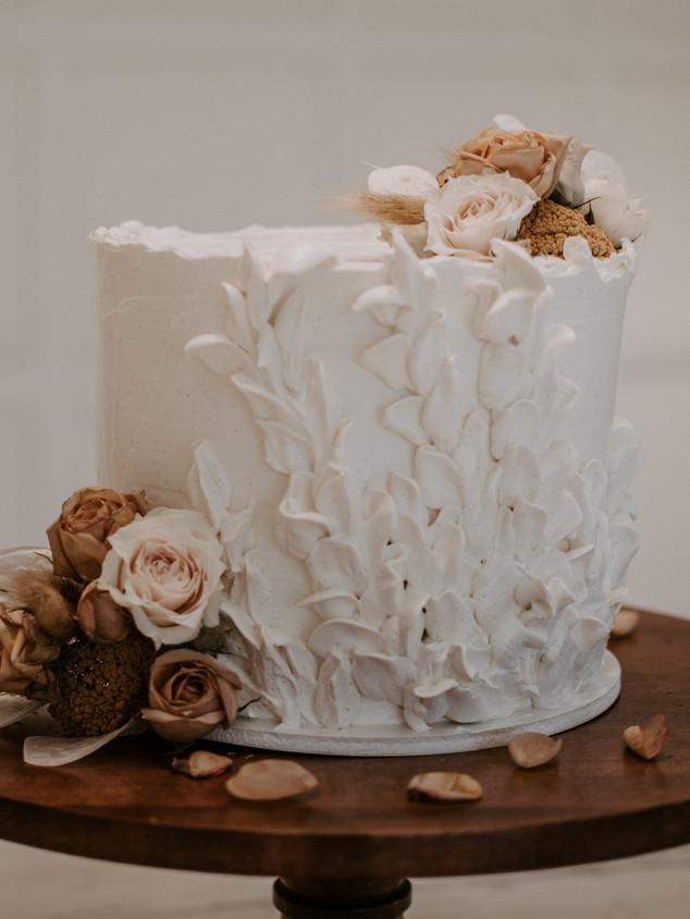Boho wedding cake with hand piping