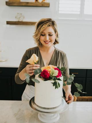Samantha decorates a cake