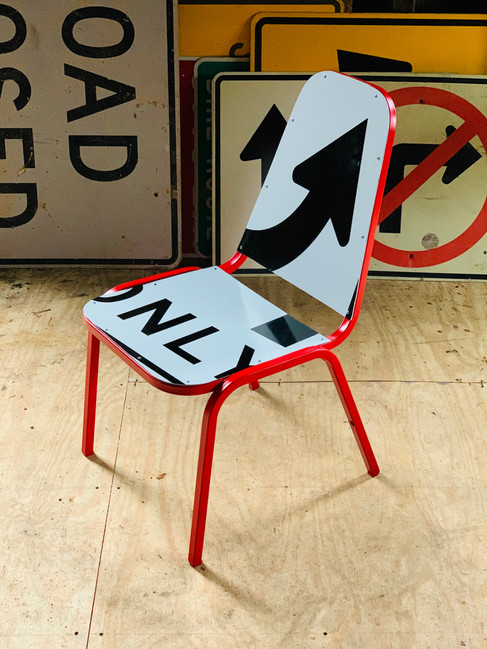 Only Up, reclaimed chair frame and street signs