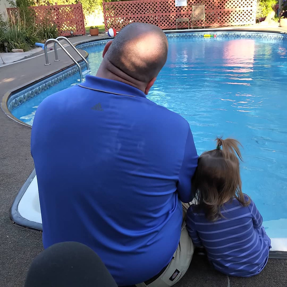 Daddy Daughter Snuggle Pool Tender Moment