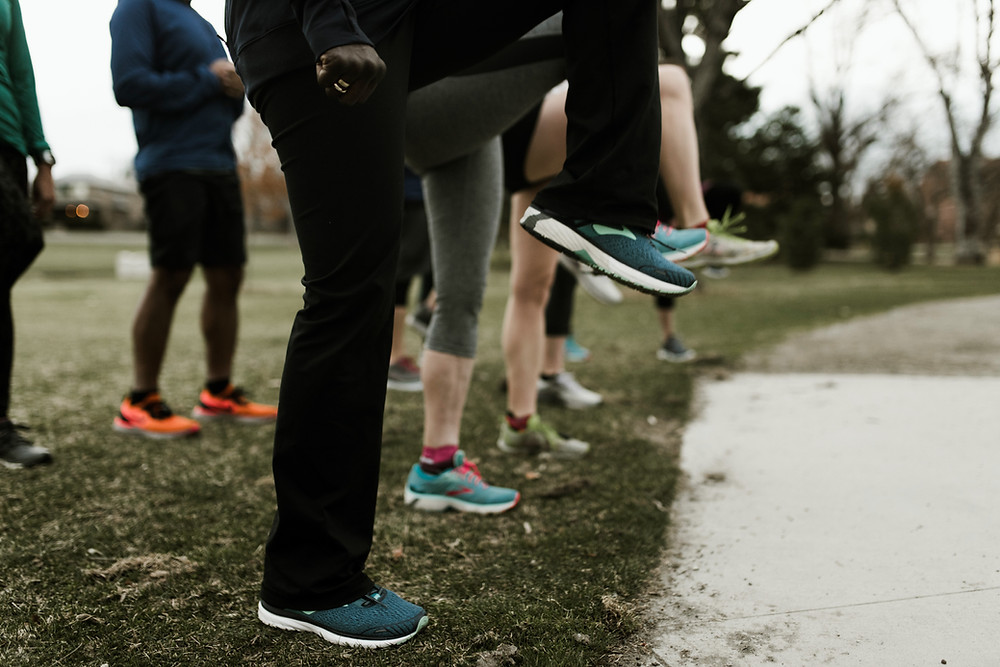 Runners warming up with silly toes coach mk fitness protection program