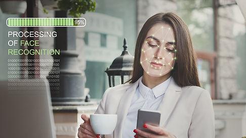 Young caucasian woman using facial recog