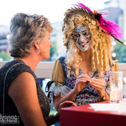 Performer Abbie chats to an attendee whilst doing her makeup