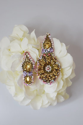 A pair of big and mini glam golden hairclips / brooches