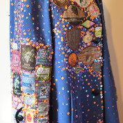 A coat embroidered with recycled cintage patches and sequins