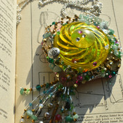 A necklace made from a light cover found in Winter Wonderland with semi precious stones, Swarovski crystals and elements from broken jewellery.