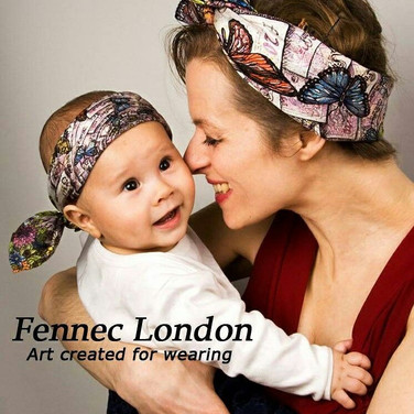 A Fennec London scarf on the head and the matching pocketsquare on the head for a baby