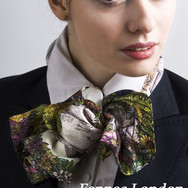 a 90cm square Fennec London scarf tied horisontally as a bow tie