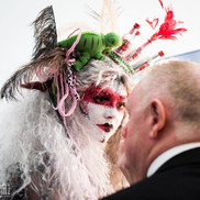 Performer Ruby makes up a gentleman at the event