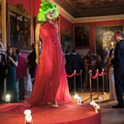 A red gown on a red catwalk in the stunning setting of Kensington Palace