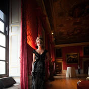 A model wears the most stunning couture gown by Catherine Walker and makeup by Anna
