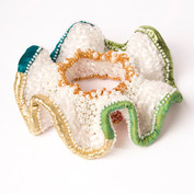 A bangle made from crochet plastic bags.