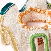 Close up of the beadwork on the bangle made from crochet plastic bags.