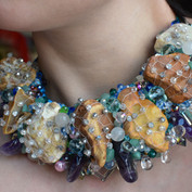 A statement necklace made from pebbles, fishnets, Czech glass beads, amethyst and other semi precious stones and Swarovski crystals.