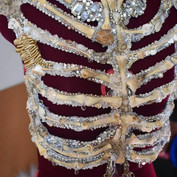 Rib cage meticulously embroidered with chicken bones, crystal beads, broken jewellery, Swarovski crystals and semi precious stones.