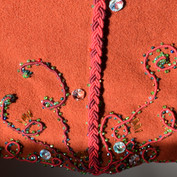 Detail of the hem embroidery on the back of the coat.