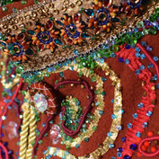 Close up of the embroidery - buttons were scratched so were covered in fishnets and crystal beads. Ribbons recycled from Lindt chocolate bunnies and recycled braiding hand stitched with crystal beads.