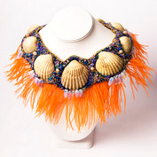 An opulent necklace made from seashells trapped in tulle, Czech glass beads, moonstones, freshwater pearls and ostrich feathers.