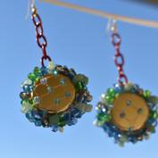 Earrings made from bottletops, fishnets, Czech glass beads and jade.
