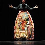 A dancer hid under the bell-like skirt and crawled out from underneath in the beginning of the performance.