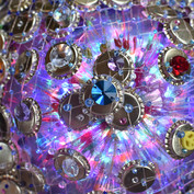 Close up of one of the star props - made from bottletops, plastic bottles and fishnets with a light inside, beaded with Swarovski crystals.