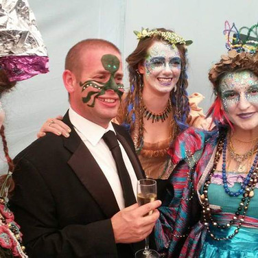 A very happy client poses for a picture with performers