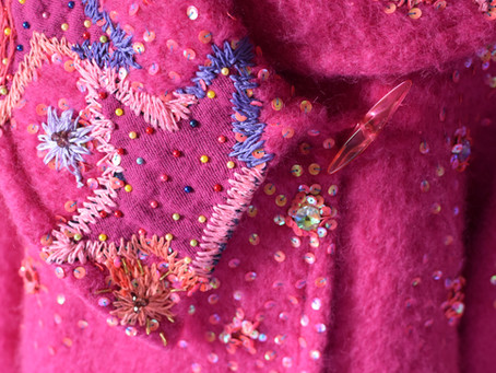 Pink coat embroidered with a Vivienne Westwood scarf.