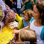The young visitors were intrigued by the intricacy of the crochet recycled costumes