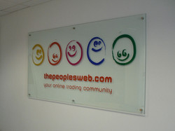 glass-sign-with-vinyl-graphics-on-studs