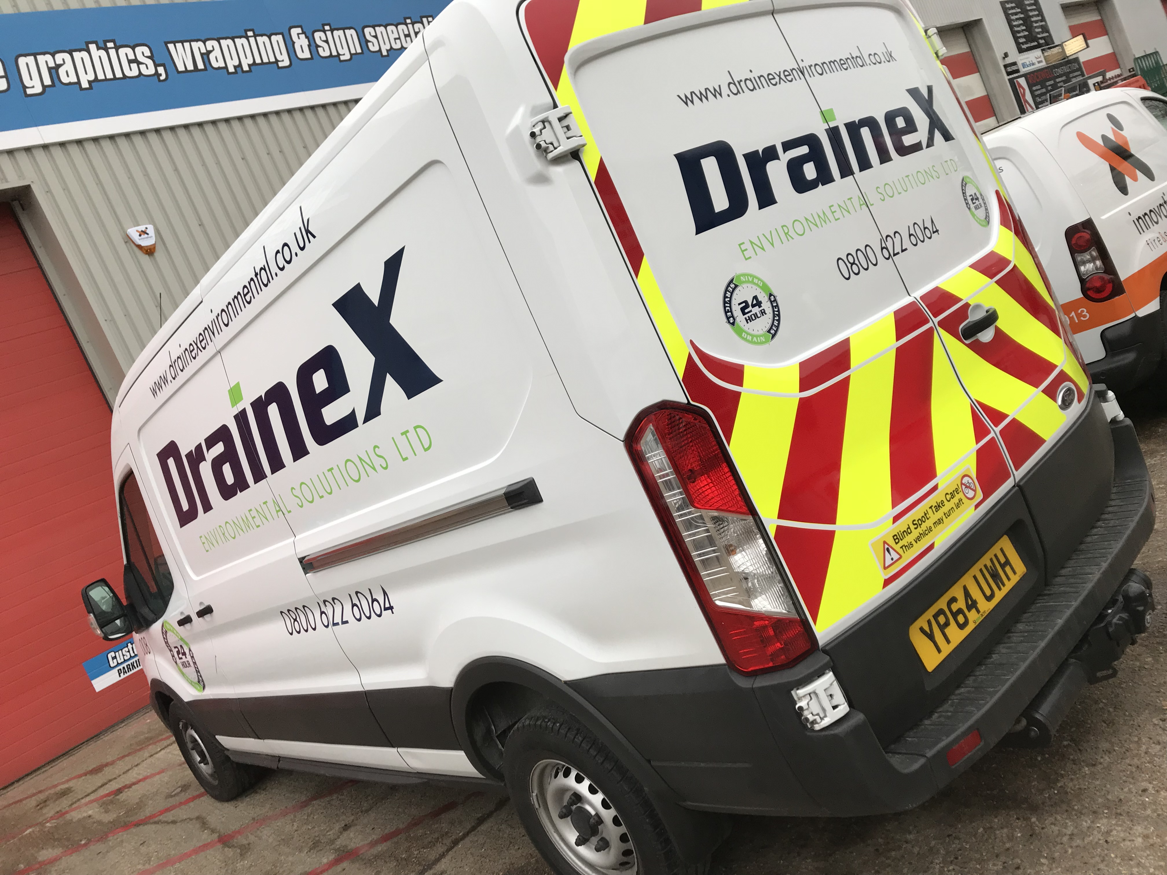 DRAINEX TRANSIT VAN WITH CHEVRONS