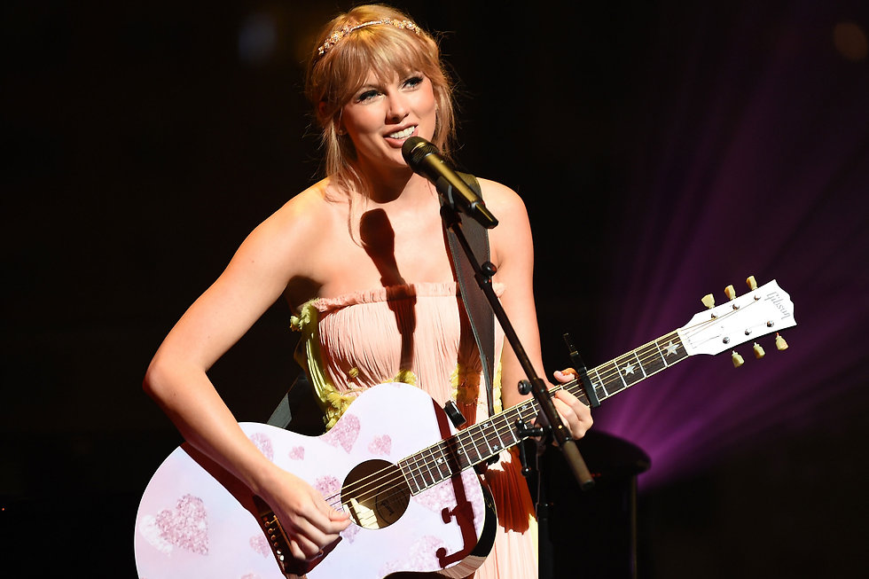 taylor-swift-with-guitar.jpg