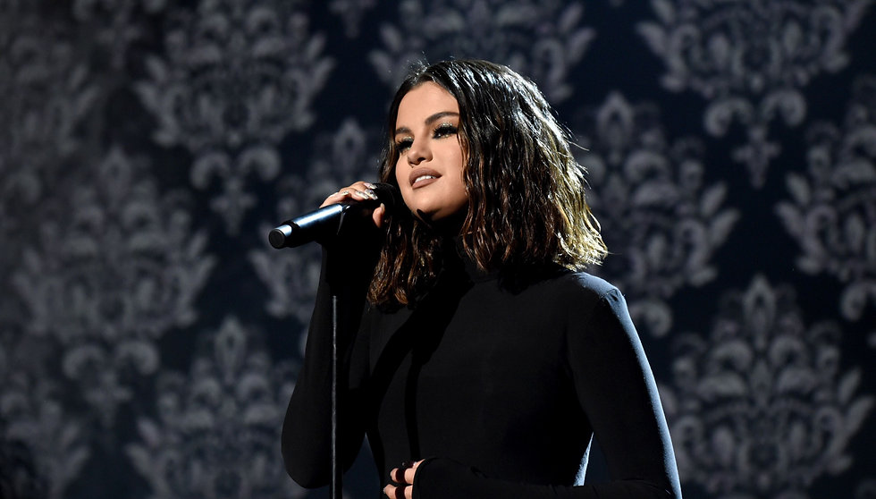 selena-gomez-performs-onstage-during-the-2019-american-news-photo-1574697030_edited_edited.jpg