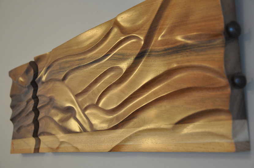 Wall Sculpture in french walnut by MarKus Furniture.