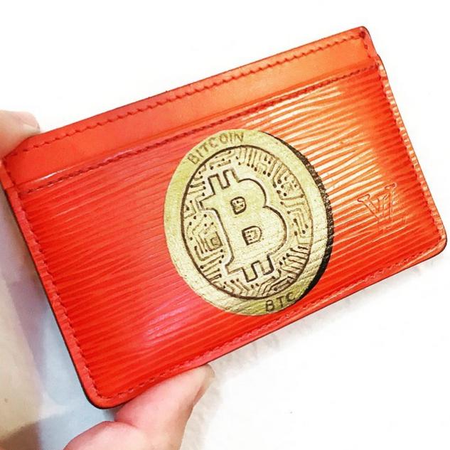 Bitcoin logo on Louis Vuitton cardholder