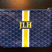 Goyard stripes and monogram clutch yello