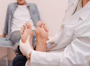 chiropodist-looking-at-mans-feet-copy-68