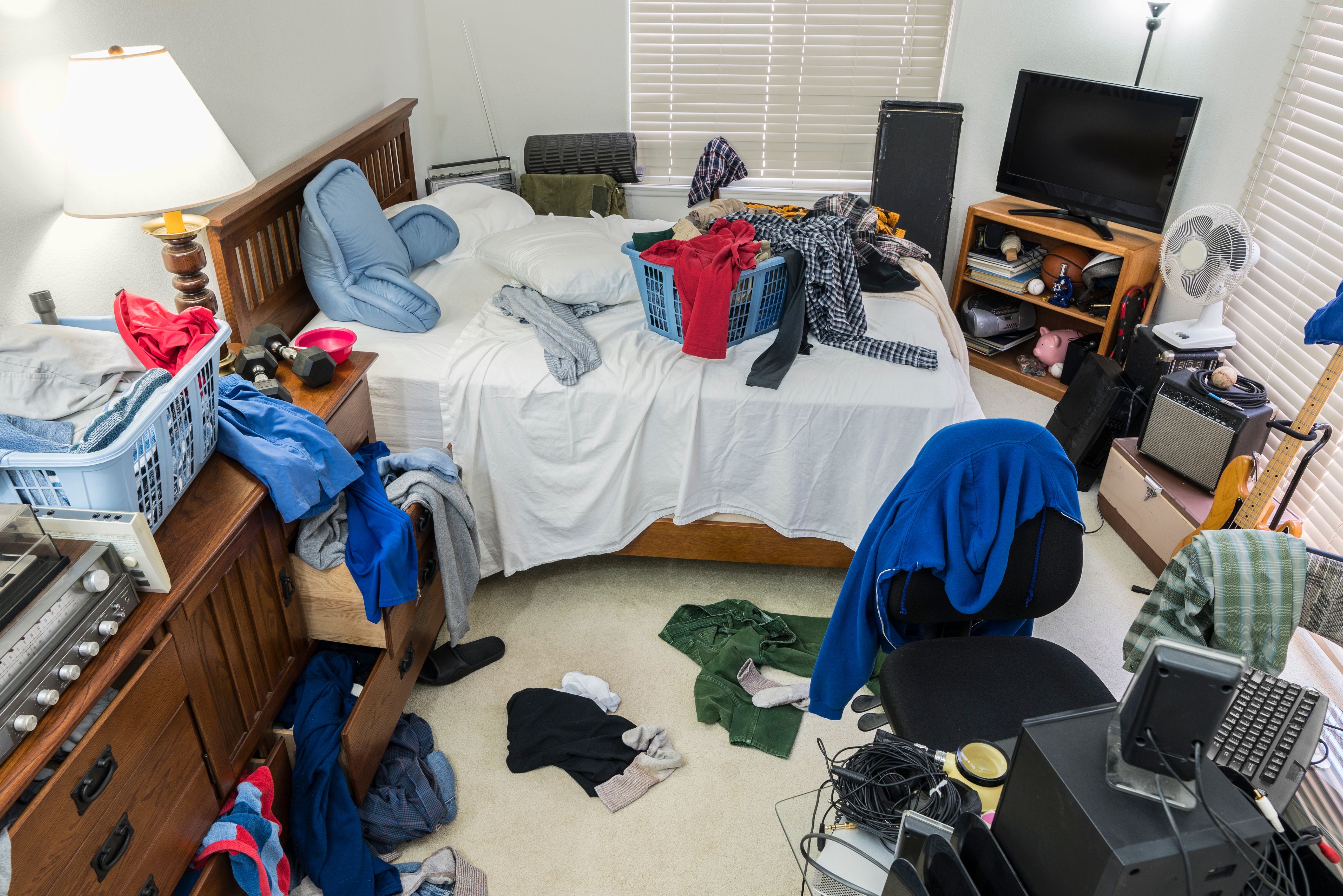 Very messy, cluttered teenage boy's bedr