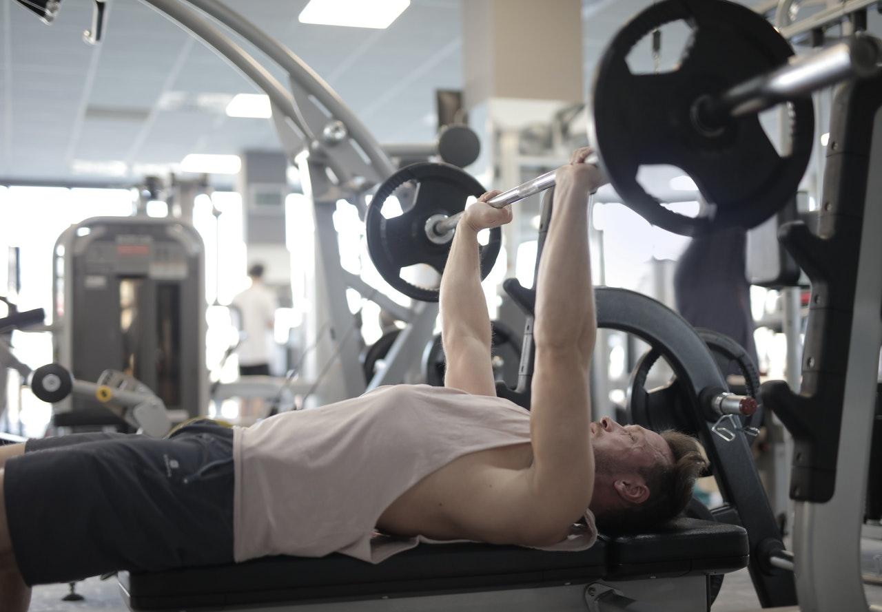 muscular-sportsman-training-with-heavy-b