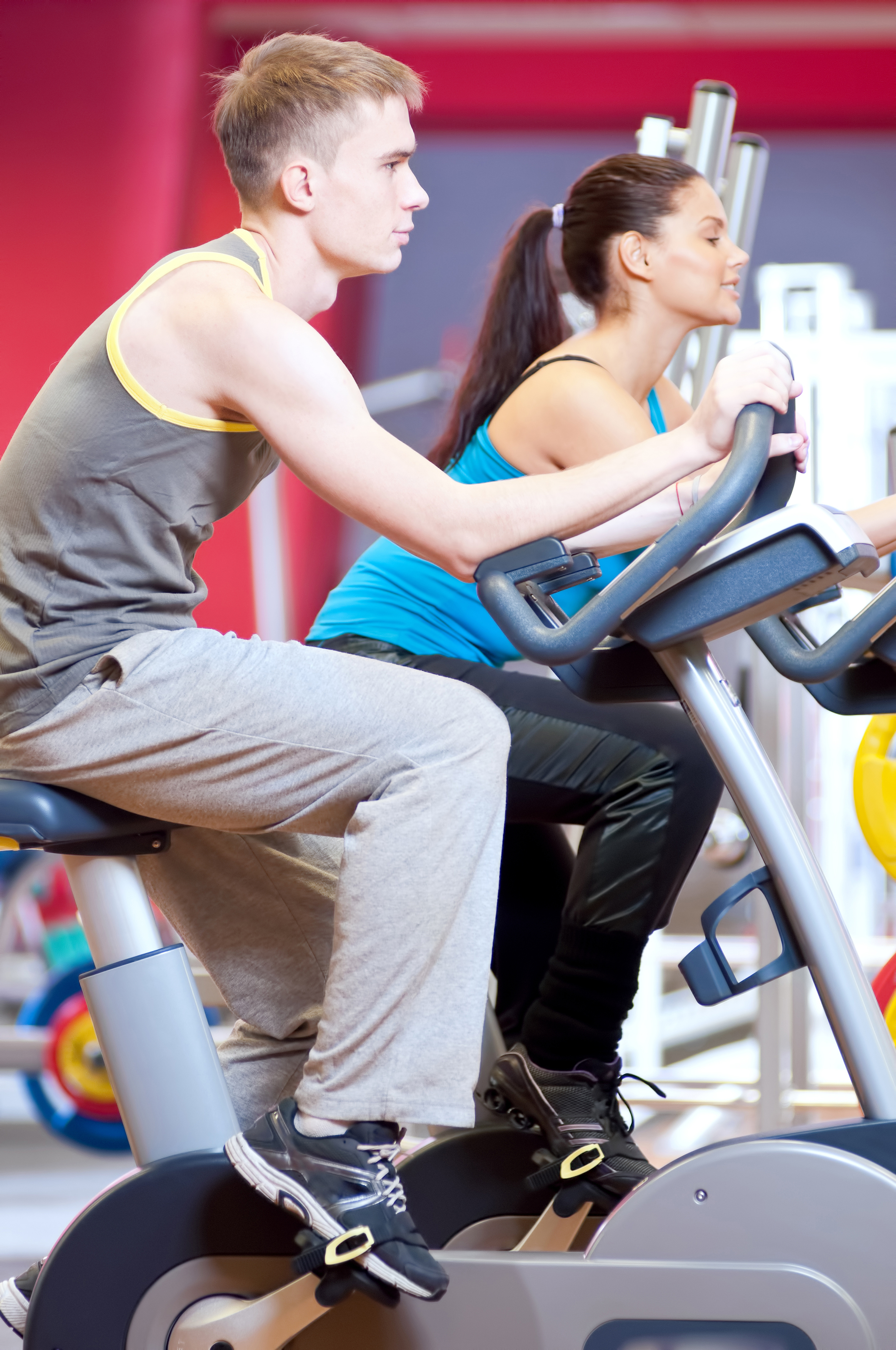two college students on treadmills