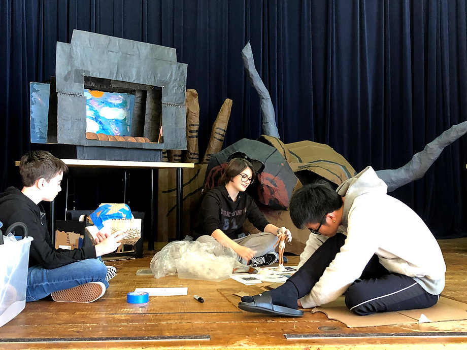 students creating theater sets and props