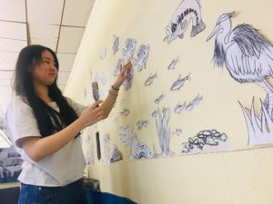 Students Install Wheat Paste Mural in the Student Lounge