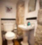 Downstairs cloakroom at Myrtle House Penzance with exposed granite walls